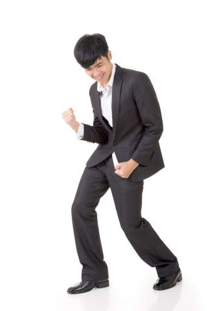 kindly: Cheerful and exciting business man portrait, full length isolated on white background.