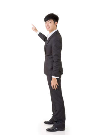 introduce: Asian businessman introduce by hand, full length portrait isolated on white background.