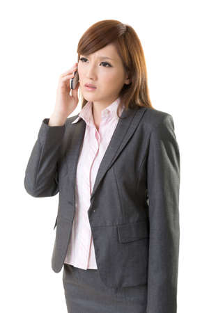 choleric: Angry businesswoman talk on phone, closeup portrait on white background. Stock Photo