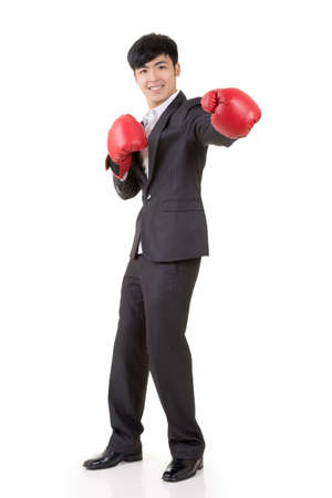 korean man: Asian businessman with boxing gloves, full length portrait isolated on white background. Concept about fight, struggle, against etc.
