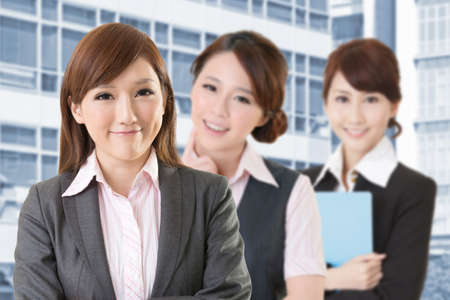 company employee: Confident Asian business woman team, closeup portrait on white background. Stock Photo
