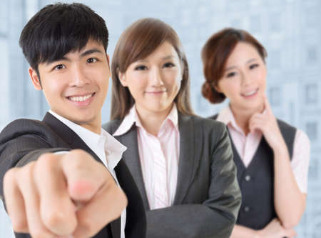 Businessman give you a gesture of want you with his team. photo