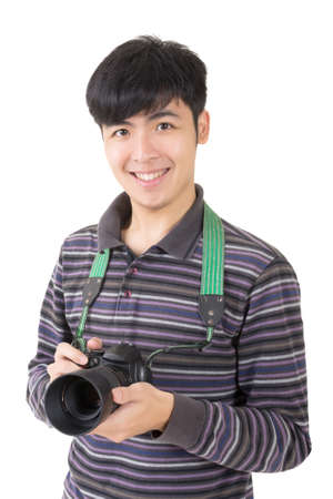avocation: Young amateur photographer of Asian hold a camera, closeup portrait on white background. Stock Photo