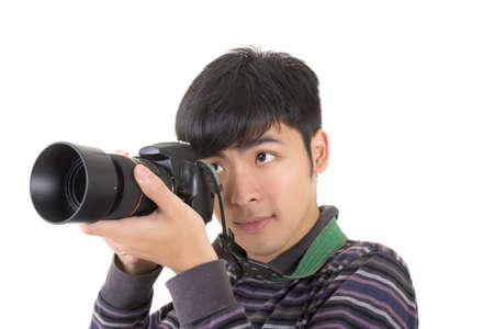 Young amateur photographer of Asian hold a camera, closeup portrait on white background. Stock Photo - 18994580
