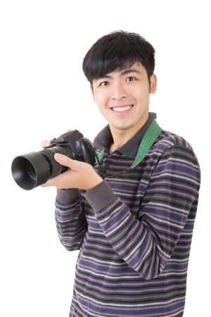 Young amateur photographer of Asian hold a camera, closeup portrait on white background. Stock Photo - 18994563