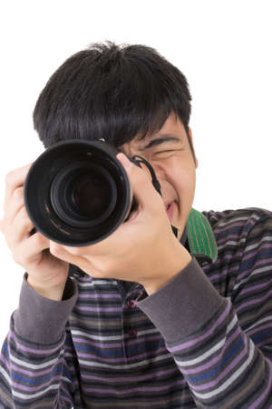 Young amateur photographer of Asian hold a camera, closeup portrait on white background. Stock Photo - 18994617