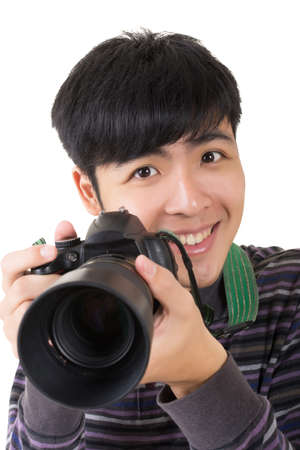 Young amateur photographer of Asian hold a camera, closeup portrait on white background. Stock Photo - 18994615