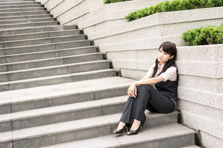 mourn: Sad business woman feel worried and stressed in outside of modern city. Stock Photo