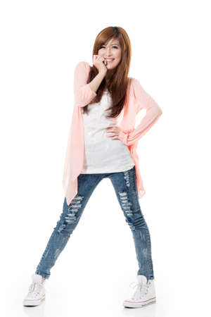 excitation: Happy smiling girl of Asian standing and posing against white studio background.