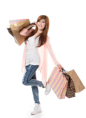 asian shopper: Cheerful shopping woman of Asian holding bags on white studio background.