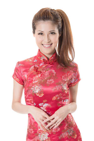qipao: Smiling Chinese woman dress traditional cheongsam at New Year, studio shot isolated on white background. Stock Photo