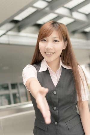 Asian business woman shake hand with you, closeup portrait in outside , Taipei, Taiwan, Asia. photo
