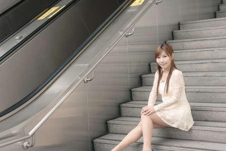 Asian beauty sit on stair, Taipei, Taiwan, Asia. photo