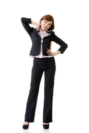 Cheerful and relaxing Asian business woman, full length portrait isolated on white background. photo