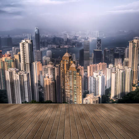 Cityscape of Hong Kong skyscrapers and skyline with wooden ground. photo