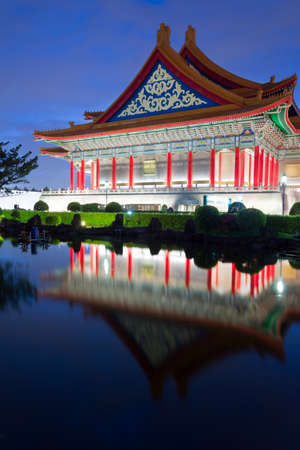 Chinese style building, National Concert Hall, with reflection on water in Taipei, Taiwan, Asia in the night