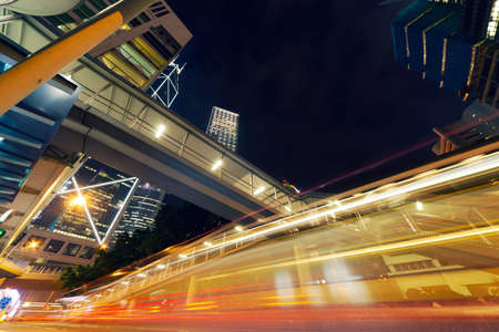 Car light in the modern city night, Hong Kong, Asia  photo