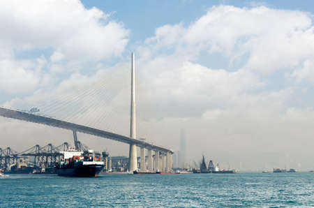 hk: Harbor and freighter with Tsing Ma Bridge in Hong Kong, Asia