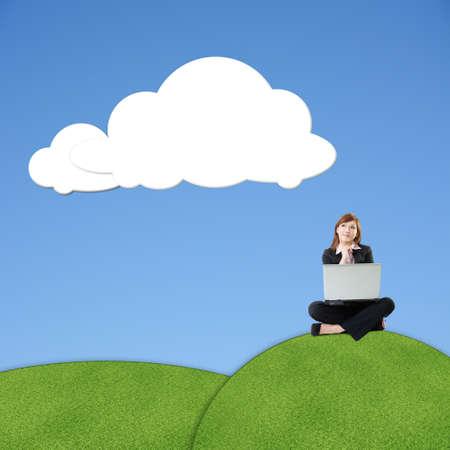 Asian business woman sit on grassland under blank white clouds, photo manipulation. photo