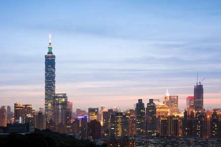 taipei: Taipei city night with famous landmark, 101 skyscraper, under blue and dramatic colorful sky in Taiwan, Asia.