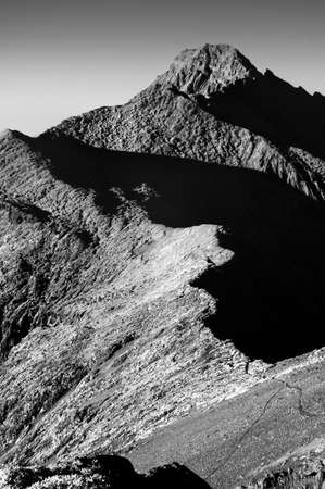 highest: Mountain scenery of famous Mt Jade(Yushan) in Taiwan, Asia. Mt Jade is the highest mountain in Taiwan and belong Yushan National park. This images was shoot as IR photo in black and white tone. Stock Photo