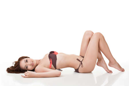 Sexy bikini woman of Asian lying down, full length portrait isolated on white background. photo
