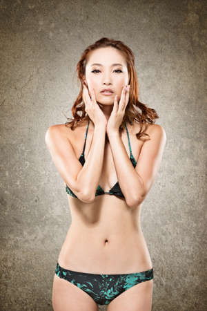Attractive Asian lady in bikini, closeup portrait. photo
