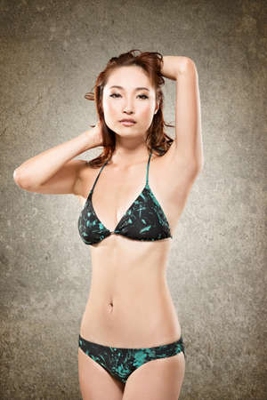 korean fashion: Attractive Asian lady in bikini, closeup portrait. Stock Photo