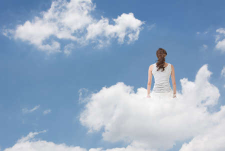 far away look: Brunet woman sit on clouds and look far away, concept of lifestyle, relaxation, free and holiday etc.