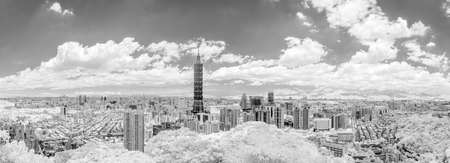 ir: Taipei cityscape with dramatic clouds at sky.