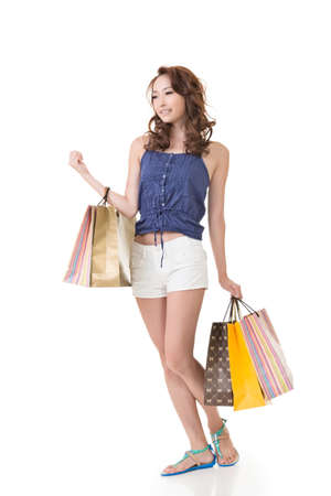woman shopping: Attractive Asian woman shopping and holding bags, full length portrait isolated on white background. Stock Photo