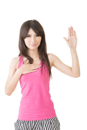 honest: Asian young woman give a gesture of swear. Isolated on the white background.
