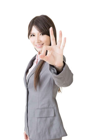 okay sign: Young business woman showing OK sign, on the white background.