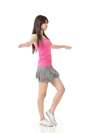 white singlet: Young asian woman walking on imaginary rope. Isolated on the white background. Stock Photo