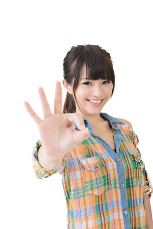 Young pretty asian woman showing OK sign with two hands. Close up portrait. Isolated on the white background. photo