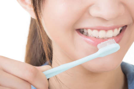 Closeup shot of woman brushing teeth. photo