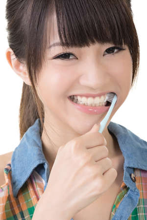 Closeup portrait of woman brushing teeth. photo