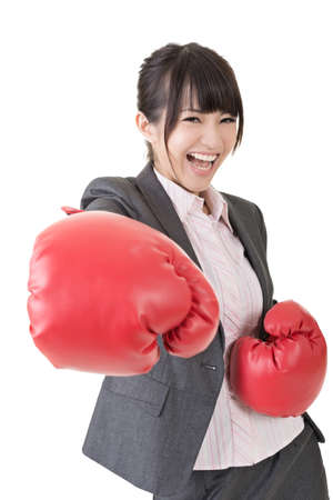 Young attractive asian business woman with boxing gloves are ready for battle. Isolated on the white background. Stock Photo - 21637379