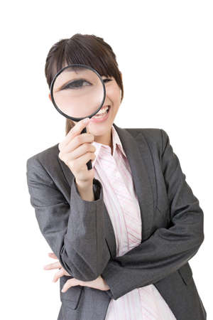 appalled: Confident young asian woman looking through a magnifying glass. Isolated on the white background. Stock Photo