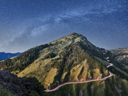 taiwan scenery: Landscape of mountain scenery with famous Hehuan East Peak under galaxy in the night, Taiwan, Asia. Digital art, photo manipulation. Stock Photo