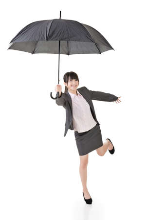 woman umbrella: Asian happy business woman holding umbrella. Isolated on the white background.