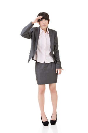happening: Young asian business woman is confused. Full length. Isolated on the white background. Stock Photo