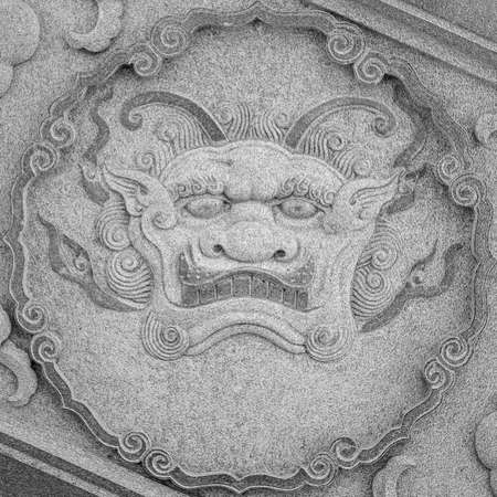 stone carving: Qilin (Kylin, Chinese unicorn) carving at temple, Taiwan, Asia.