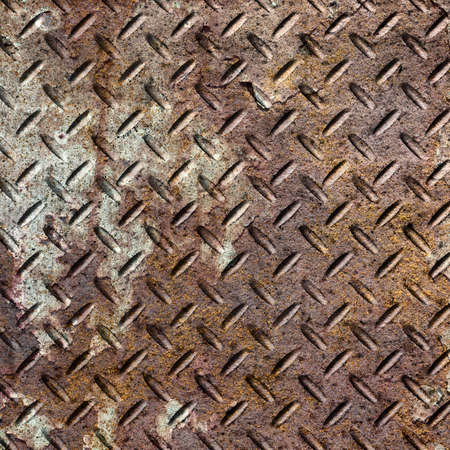 Background of old metal diamond plate in brown color. Stock Photo - 21789222