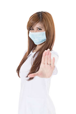 woman stop: Asian nurse wear mask and give you a stop sign, closeup portrait on white background.