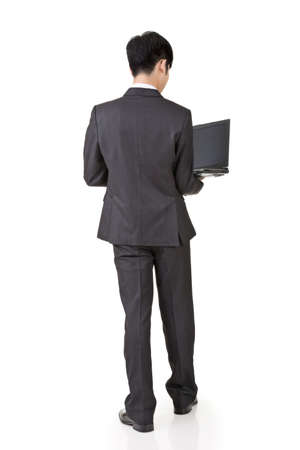 Rear view of Asian business man use laptop, full length portrait isolated on white background. photo
