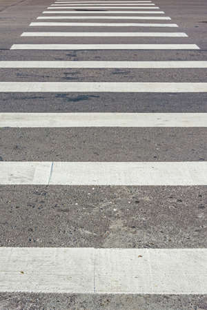 Zebra pedestrian crossing, traffic walk way for people. Vertical position photo