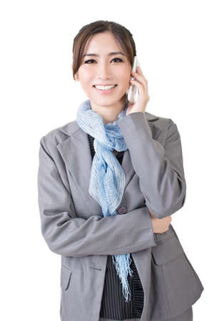 Young asian businesswoman speaking on the cell phone. A portrait isolated on the white background. photo
