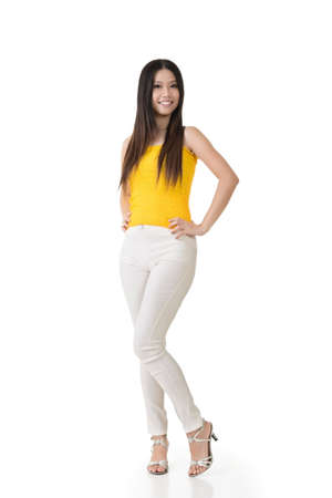 Asian beautiful young woman posing. Full length portrait. Isolated on white background.