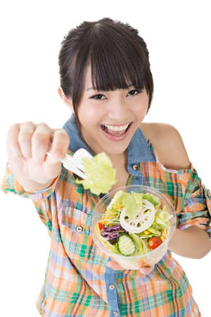 proposes: Asian pretty woman gives, offers, proposes a salad to the camera. Closeup portrait. Isolated on the white background. Stock Photo